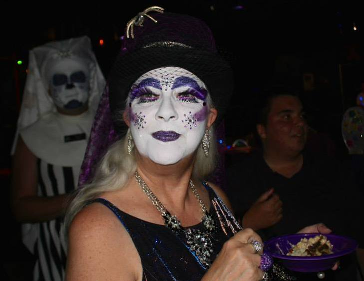 Sister Hecate of the Bodacious Tatas enjoys the mashed potato bar at the 2014 Purple Party.